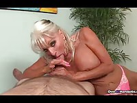 Hot busty mature milking a guy's dick for fun