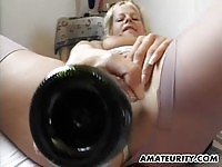 Busty blonde amateur uses a bottle to get herself off