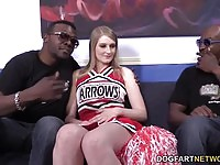 Sweet cheerleader takes two black cocks