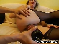 Amateur blonde in stocking got examined in the couch