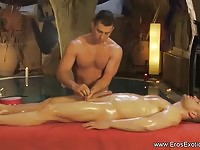 Gay masseuse performing cock massage on client