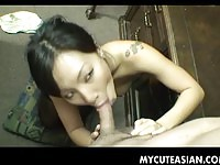Asian girlfriend on her knees sucking cock