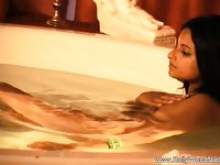 Bollywood babe having erotic massage in bathtub