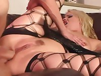 Fishnet blonde beauty takes one in the ass