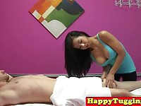 Busty Asian Masseuse Tugging Her Client