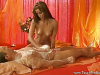 Gorgeous masseuse in handjob action
