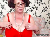 Horny grandma with glasses gets naked on webcam