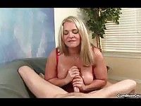 Blonde Mature MILF Enjoys Tugging Young Cock