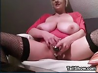 MILF with huge breasts gets naughty on camera