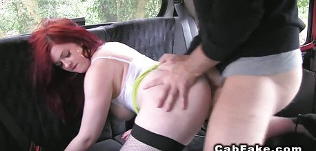 All wet redhead beauty fucking in a cab