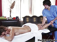 Stunning brunette client nailed by the masseur
