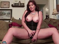 Mature with huge natural breasts goes solo