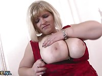 Horny BBW blonde lady nude by the tree