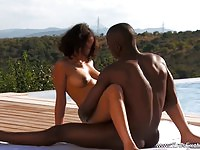 Black couple having intercourse by the pool