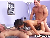 Asian nympho ends up double penetrated by two white cocks