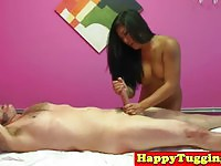 Inked Asian masseuse tugs dick like a pro