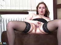 Dreamy brunette MILF in stockings masturbates