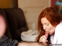 Alluring redhead wife gives a romantic blowjob