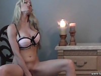 Blonde MILF masturbates in the chair with a vibrator