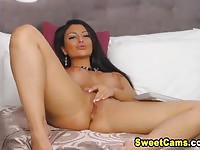 Busty brunette cam girl fingers her shaved pussy for an orgasm