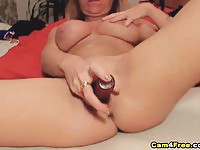 Sexy cam girl fingers her snatch before using a toy