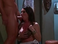 A brunette having sex at the tolet