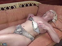 Blonde granny in solo fingering action