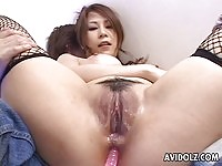 Busty Yuki Aida tries many toys in her ass