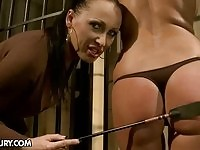 Busty mistress torturing her naked imprisoned slave