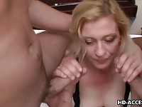 Mature blonde does two young dongs