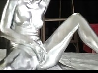 A metallic statue masturbating