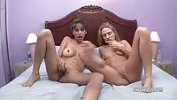 Two lovely babes toying side by side